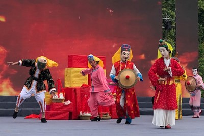 """Photo shows the performance of Nuoxi, a kind of drama included in """"Feitao"""", a national intangible cultural heritage of Maonan ethnic group."""